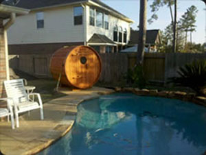 RW Saunas Barrel Sauna next to pool