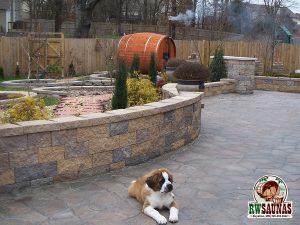 RW Saunas Barrel Sauna in yard with dog in foreground